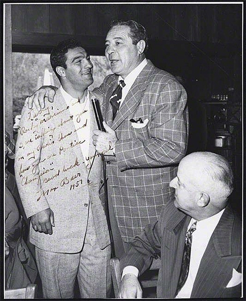 Vintage photograph of Max Baer and Rocky Marciano, Inscribed by Baer.